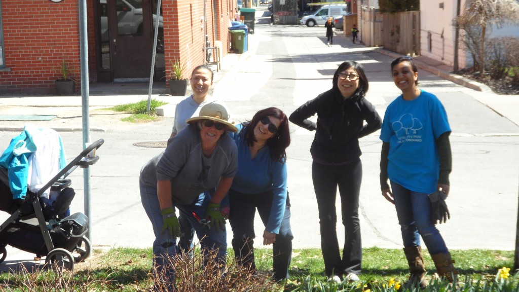 The Stewardship team from Ben Nobleman Park Community Orchard struts their stuff after a few hours of working in the pollinator garden.