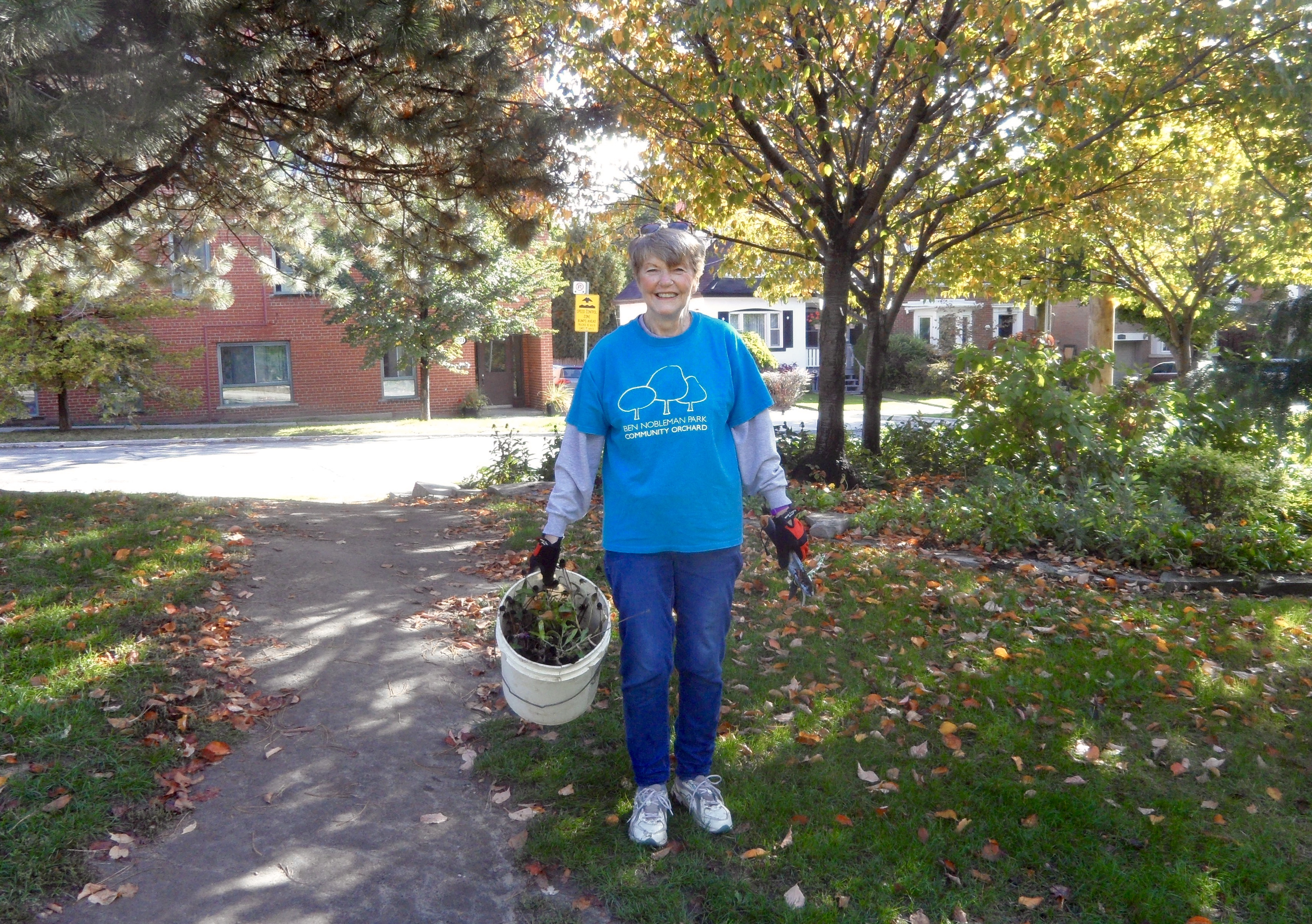 Lynn giving thanks for fruit trees in Ben Nobleman Park Community Orchard